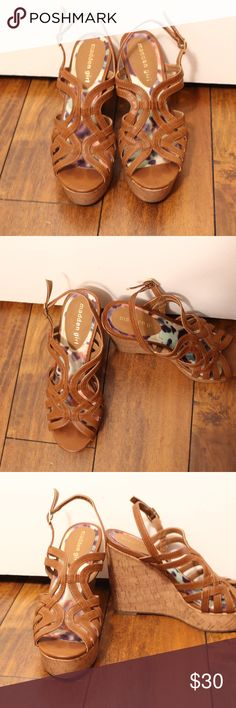 """NWOT Madden Girl Elite Wedge Sandals NWOT Madden Girl Cognac Elite Wedge Sandals. Size 8 in Women's. Open toe with multiple straps and cut out details. Cork wedge heel, approx. 5"""" with 1.25"""" platform. Ankle buckle strap at ankle. Madden Girl Shoes Wedges"""