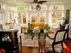Exactly what I'm thinking for our sunroom, conversation piece with bar and windows exposed!