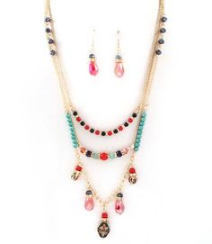 Layers of Poppy and Ebony Agate, Turquoise Howlite and Vitrail Crystals mixed with Inlayed Coral and Sliced Turquoise Charms