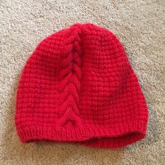 red slouchy cable knit beanie Handmade by me! Never worn, only tried on to model. Accessories Hats