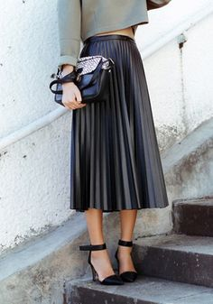 Wish I could carry these skirts off - gorgeous. Tanya Burr Style Steal: Pleated Black Leather Skirt