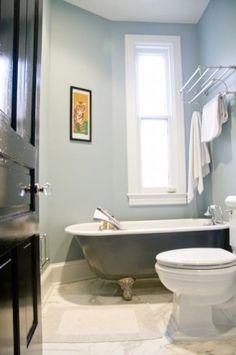 colors for guest bathroom. light blue walls, charcoal gray vanity, black door, white trim.