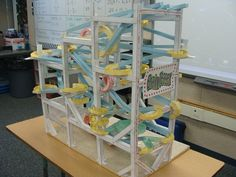 How cool of a STEM project would this be?! Make marble roller coasters out of paper and tape.