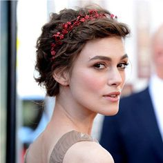 This bold flower headbands adds contrast and style to short hair.