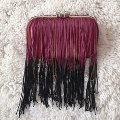 Gorgeous purple & black tassel clutch NWOT Gorgeous purple & black tassel clutch, rhinestone button closure. Gold chain strap included. Brand New Never Used✨ not topshop tagged for views Topshop Bags Mini Bags