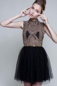 Black tulle skirt with gold beaded top, thin gold belt with geometric design