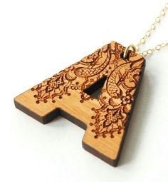Wooden letter necklace -a letter A in wood make a good key ring for me and I could do pyrography on it, couldn't I? Wood Burning Crafts, Wood Burning Patterns, Wood Burning Art, Wood Crafts, Laser Art, Laser Cut Wood, Laser Cutting, Wood Laser Engraving, Engraving Ideas