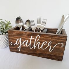 made of solid pine sanded smooth stained dark walnut lettering is silverware caddysolid