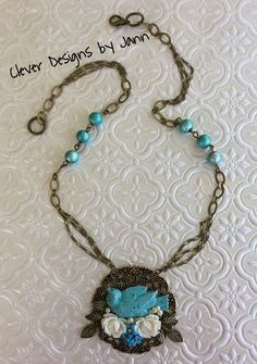 July Challenge .. Almost everything I used in this necklace is from B'sue .. which are a bird, brass filigree stamping, roses, leafs and spectra beads .. I used Turquoise Iced Enamel on the bird .. Jann Tague .. Clever Designs ..https://www.facebook.com/JewelsByJann