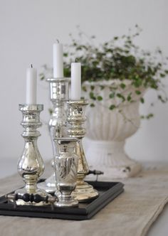 love the silver and white with the black tray and greenery.