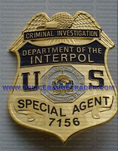 Interpol badge. Available from www.policebadgetrader.com