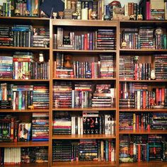 Interesting way to organize series / collections on bookshelves.  Could do similar, by topic, for non-fiction.