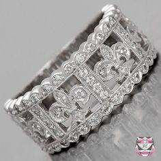 Fleur De Lis Wedding Band - Special Order  Beautiful! But wayyyyyy out of the price range. Wayyyyyy.