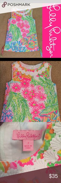 2016 Lilly Pulitzer girls classic shift dress In excellent condition! No flaws! 🙆🏻no trades or off site transactions.Since I have a variety of sizes I do not model🙅🏻Low ball offers are not accepted. Please accept that I offer the lowest price I'm willing to offer at that point😁I have an illness that sometimes requires serious medical attention & 2 little ones 👶🏼👶🏻 so if I don't respond I'm either very ill that day 🚑 or have been kidnapped by my kids.Thank you for shopping my…