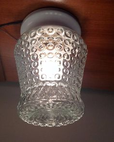 Though not a true Jelly Jar Fixture - it sure looks good. No idea of the manufacturer. The glass globe has pebbly effect or berry effect with the pebbles going from large to small and then a tear drop shaped design around the top. This would be a great entrance light, or a
