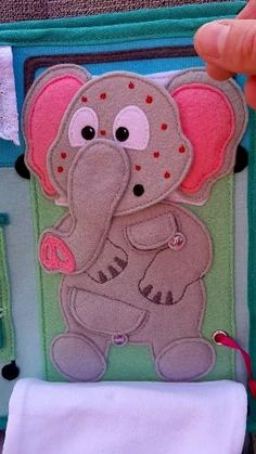 This is a page from the hospital quiet book. Change the face of the elephant! Diy Quiet Books, Baby Quiet Book, Felt Quiet Books, Quiet Book Templates, Quiet Book Patterns, Pattern Books, Infant Activities, Book Activities, Quiet Book Tutorial
