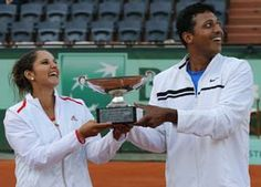 Sania Mirza and Mahesh Bhupathi won their second Grand Slam title together and first French Open trophy after crushing the challenge of Klaudia Jans-Ignacik and Santiago Gonzalez in the mixed doubles final, here on Thursday.
