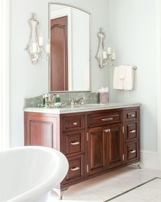 """Amanda Webster Design on Instagram: """"It's all in the details! This rich vanity complete with metal feet, gorgeous wall sconces, and beautiful stone countertop make the corner…"""" Stone Countertops, Double Vanity, Wall Sconces, Amanda, Corner, Bathroom, Detail, How To Make, Beautiful"""