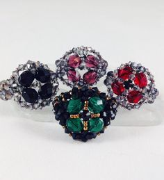 Join me on Facebook http://www.facebook.com/BronzeponyBeadedJewelry Materials: 4 - 6mm Firepolished Beads - Emerald 60+ 3mm Bicones - Swarovski Jet 15/0 Seed...