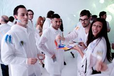 """The invitation instructed guests to wear all white, with the note that """"protective gear"""" would be provided. At the event for guests to paint at will!"""