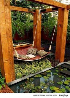 Awesome garden idea....table for dinning/entertaining...hammock above small garden n small pond♥