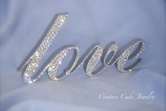 """It's ALL in the Sparkle!  """"love"""" Wedding Cake Topper covered in Swarovski Crystals."""