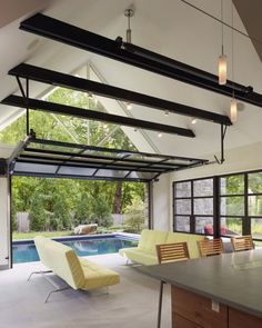 """The Pool House was pushed against """"the pool, preserving the lot and creating a dynamic relationship between the 2 elements.""""  Fantastic!"""