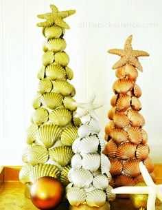 Metallic Sea Shell Christmas Trees from At The Picket Fence : If I ever find myself a beach house owner, I will need to decorate it for Christmas.
