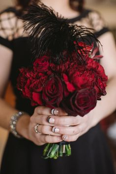 rich red bridesmaid bouquet with feather // photo by Jenelle Kappe Photography