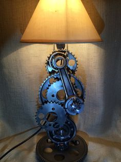 Metal table lamp from motorcycle Husaberg components, serious metal art work piece