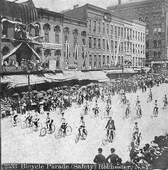 """Bicycle Parade (safety) Rochester, NY. Image from stereoscopic view. """"Rochester's History: An Illustrated Timeline,"""" http://www.vintageviews.org/vv-tl/Photos/pages/parade2.html"""