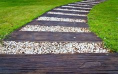 Walkway made of wood and stone on the grass Stock Photo