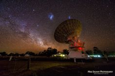 The Large (left) and Small (right) Magellanic Clouds are seen in the sky above a radio telescope that is part of the Australia Telescope Compact Array at the Paul Wild Observatory in New South Wales, Australia. Archaeology News, Magnetic Field, Space And Astronomy, Light Year, Deep Space, Milky Way, Stargazing, Night Skies, Cosmos