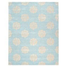 Washed in turquoise and yellow tones, this hand-tufted wool rug offers a touch of exotic intrigue with its intricate medallion motif.  ...
