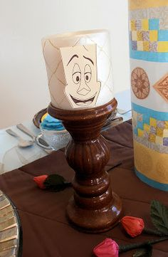 Easy Lumiere candlestick decoration for a Beauty and the Beast party