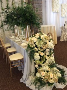 Cascading head table floral. The Watering Can St.Catharines