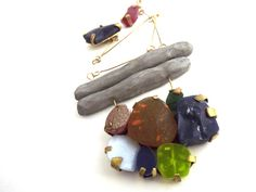 By the River bed, necklace 2013 Pigment infused resin stones, polymer clay and red brass
