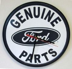 """Any car lover will love hanging this clock in their garage. Measuring 12 1/2"""" in diameter. Quartz movement and requires 1 AA battery.   Our Price: $24.95  Availability: In Stock"""