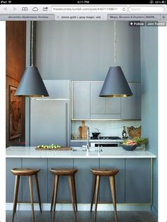 Love this kitchen and the touch of brass