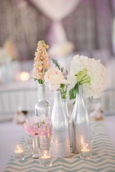 DIY Silver Glittery Bottle Centerpieces