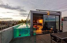 Beton, glas en een zwembad op het dak