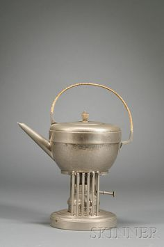 Arts & Crafts Teakettle on Stand  Hammered silver-plated metal  F. & R. Fischer, Göppingen, Germany, early 20th century  Half-oval form teapot with turned wooden finial on the cover and cane-wrapped upright handle on a circular stand with vertical rod supports, with conforming burner.