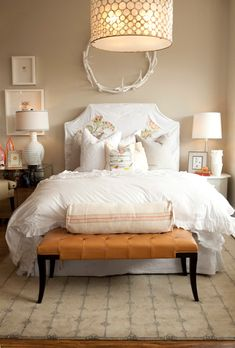 Styling a nightstand.  I like the mismatched lamps, tables etc...I just don't know if my anal self could handle not having things match on both sides.  I also kind of like the antlers above the headboard.