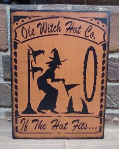 Ole Witch Hat Co. Primitive Unique Handpainted Halloween Wood Witch Sign. $24.99, via Etsy.