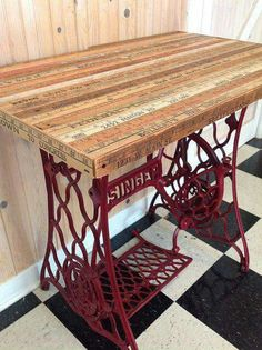 An old sewing machine treadle base with a table top made from vintage yardsticks. Gorgeous!