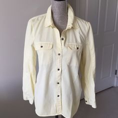 Madewell yellow button down shirt Comfortable and stylish button down shirt by Madewell in pale yellow fabric features double breast pockets, tab closure at collar. Back hem is slightly longer than front. 100% cotton Measurements: Bust: 38 in.  Sleeve:30 in.  Length:27 in. (Front) 30 in. (Back) Madewell Tops Button Down Shirts