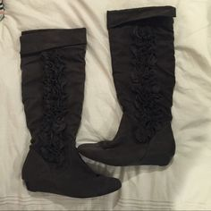 Dark gray ruffled boots A dark grey dress boot with a ruffled design on the side. Hardly worn and still in good condition! Size 7.5! Shoes Heeled Boots