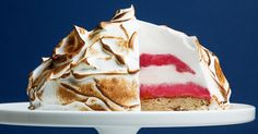 Baked Alaska -- Meet the retro dessert that's making a big, fiery comeback . Learn how to master the Baked Alaska, an impressive, flaming dessert of meringue, ice cream and cake. Dessert Party, Party Desserts, Just Desserts, Baking Desserts, Flambe Desserts, Alaska Cake, Baked Alaska Recipe, Ginger Ice Cream, Cake Recipes