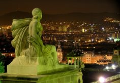 Barcelona, Spain, Statue guarding the city at night. I've actually been here and I love it!