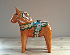 Vintage hand carved traditional Swedish Dala Horse wood figurine / candle holder by Nils Olsson on Etsy, $44.00
